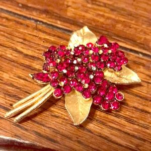 Flower brooch with red stones